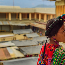 Ixil woman standing in front of the market, Chajul, Guatemala.