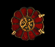 Disc brooches, silver, gold and garnet. 550-600,  France.