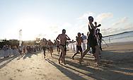 2010 Noosa Triathlon Festival.ENDURA Noosa Run Swim Run.Senior competitors finish the first leg of the run swim run..27/10/2010.Noosa Main Beach, Noosa, Queensland, Australia.