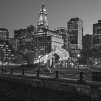 B & W Boston North End Christopher Columbus Waterfront Park night photography from New England Photography Guild member and award winning fine art photographer Juergen Roth showing Boston Custom House of Boston, the waterfront and parts of the Columbus Park and Boston Marriott Long Wharf hotel. The Boston skyline was photographed on a beautiful spring sunset. <br />