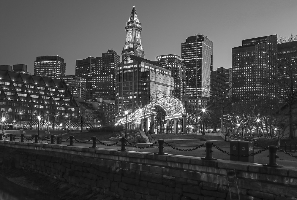 B &amp; W Boston North End Christopher Columbus Waterfront Park night photography from New England Photography Guild member and award winning fine art photographer Juergen Roth showing Boston Custom House of Boston, the waterfront and parts of the Columbus Park and Boston Marriott Long Wharf hotel. The Boston skyline was photographed on a beautiful spring sunset. <br />