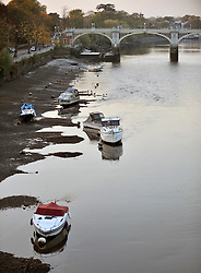 ©London News pictures...  01/11/12 Richmond lock is left in an open position in order for the water from The River Thames to flow out enabling a riverbed inspection. The Richmond lock and weir complex was built in 1894 to maintain a navigable depth of water upstream of Richmond.For about two hours each side of high tide, the sluice gates on the grade II listed structure which make up the barrage are raised into the footbridge above, and river traffic can pass through the barrage unimpeded. For the rest of the tidal cycle the sluice gates are closed,