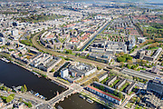 Nederland, Noord-Holland, Amsterdam, 09-04-2014; Amstel met Berlagebrug, Prins Bernhardplein. Transvaalkade en Rindijk Ringvaart Watergraafsmeer). Amstelstation, spoorlijn naar Centraal station.<br /> River Amstel.<br /> luchtfoto (toeslag op standard tarieven);<br /> aerial photo (additional fee required);<br /> copyright foto/photo Siebe Swart