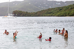 Attendees enjoy the water during the 31st Annual Texas Society Chilli Cookoff Brewers Bay.  St. Thomas, USVI.  16 August 2015.  © Aisha-Zakiya Boyd