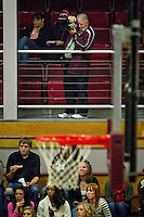 Don Sausser photographs the North Idaho College men's baskeball team from the upper seating areas Thursday, Nov. 11, 2010.