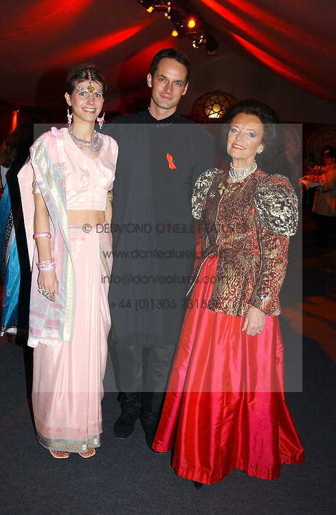 """Left to right, JAMES & CAROLINE JOHNSTONE he was chairman of the ball and LADY NEWALL at the 10th annual British Red Cross London Ball.  This years ball theme was Indian based - """"Yaksha - Yakshi: Doorkeepers to the Divine"""" and was held at The Room, Upper Ground, London on 1st December 2004.  Proceeds from the ball will aid vital humanitarian work, including HIV/AIDS projects that the Red Cross supports in the UK and overseas.<br /><br />NON EXCLUSIVE - WORLD RIGHTS"""
