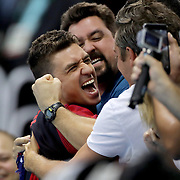 Swimming - Olympics: Day 7  Anthony Ervin of the United States celebrates with supporters in the crowd after his medal presentation for winning the Men's 50m Freestyle Final during the swimming competition at the Olympic Aquatics Stadium August 12, 2016 in Rio de Janeiro, Brazil. (Photo by Tim Clayton/Corbis via Getty Images)