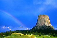 Clouds and a rainbow over Devils Tower after a thunderstorm.  Devils Tower National Monument, Wyoming.