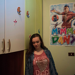 Rosa Visalli, 18 years old, poses inside her room in Giuliano in Campania. She is a great fan of Mimmo Dany.