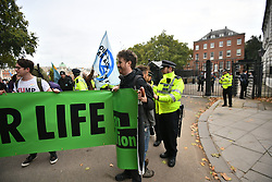 © Licensed to London News Pictures. 07/10/2019. London, UK. Extiction Rebellion protestors are greeted by police at the back entrance to downing street in Westminster . Activists will converge on Westminster blockading roads in the area for at least two weeks calling on government departments to 'Tell the Truth' about what they are doing to tackle the Emergency. Photo credit: Ben Cawthra/LNP