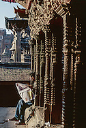 Reading news in Kathmandu Durbar square in the morning sun.
