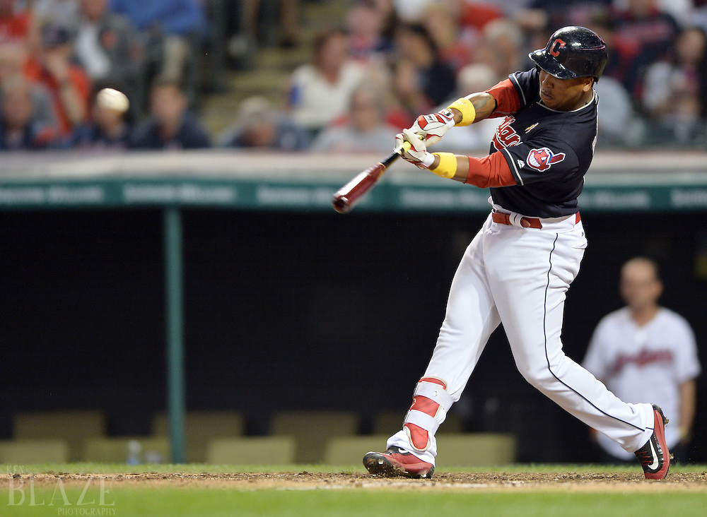 Sep 2, 2016; Cleveland, OH, USA; Cleveland Indians third baseman Jose Ramirez (11) hits a double during the fifth inning against the Miami Marlins at Progressive Field. Mandatory Credit: Ken Blaze-USA TODAY Sports