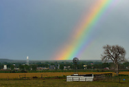 Windmills and water towers are common sights in Nebraska and I had to capture this rainbow over both of them.