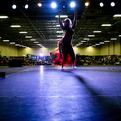 A burlesque dancer performs during the 208 Tattoo Festival held at the Idaho Expo Center. The 208 Tattoo Festival runs through June 14th and features tattooing, performances, painting, music, and an art wall. Saturday June 13, 2015