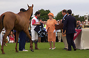 H.M. the Queen gives an award to a horse called 'Glitter', Cartier International Day at Guard Polo Club, Windsor Great Park. 25 July 2004. SUPPLIED FOR ONE-TIME USE ONLY-DO NOT ARCHIVE. © Copyright Photograph by Dafydd Jones 66 Stockwell Park Rd. London SW9 0DA Tel 020 7733 0108 www.dafjones.com