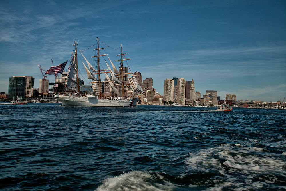 USCGC Eagle passing FAn Pier, Rowes Wharf & The Boston Harbor Hotel, spans 295 ft and weights 1655 tons. The Eagle was Built in Germany in 1936 and was utilized by the German Navy before WWII.  After German's, defeat the US siezed control of the ship and has been used as USCG Cutter ever since. (Boston Globe)  Homeport New London, CT