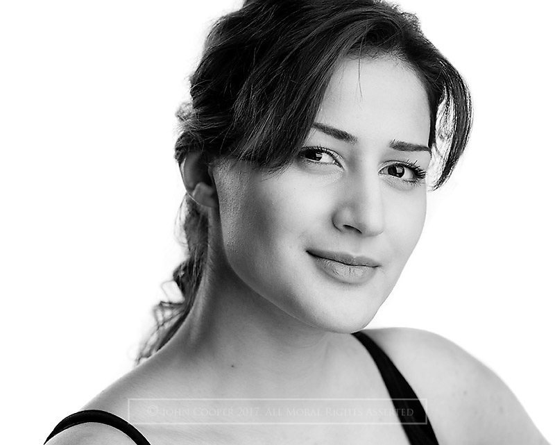 Headshot of actress Aneesa Amani Butt.