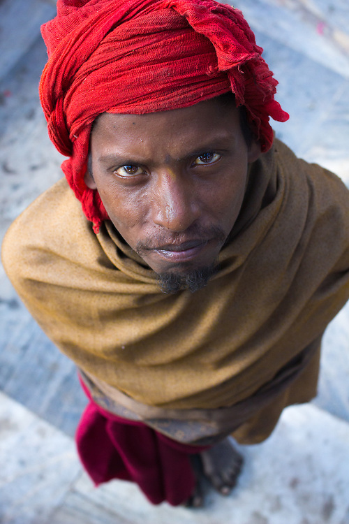 Portrait of an Indian hindu pilgrim at the ghats of Kathmandu, Nepal. He walked all the way from Varanasi in India to Kathmandu. Barefooted.