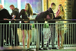"""© Licensed to London News Pictures . 22/12/2018 . Manchester , UK . A man vomits over railings at Deansgate Locks . Revellers out in Manchester City Centre overnight during """" Mad Friday """" , named for historically being one of the busiest nights of the year for the emergency services in the UK . Photo credit : Joel Goodman/LNP"""