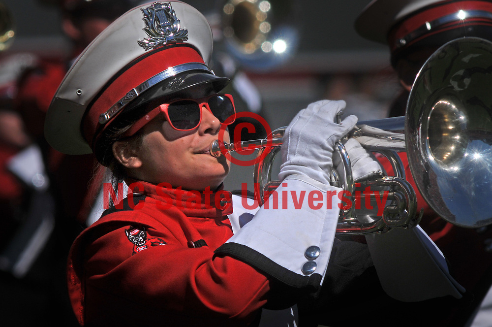 Member of the NC State marching band plays prior to the start of the football game in Carter-Finley Stadium.