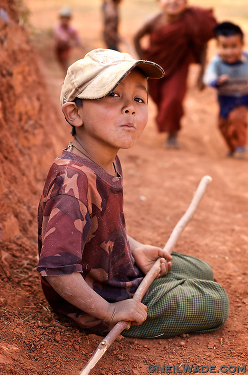 This boy was playing with his friends when I caught a brief moment of him resting in a hill village near Hsipaw, Burma (Myanmar).