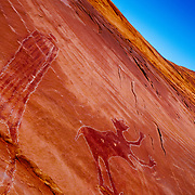 White chalk outlines an ancient Indian pictograph, Black Dragon Wash.