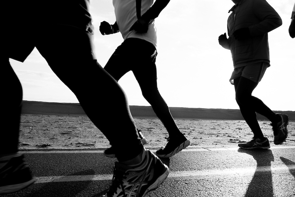 Runners running along Chicago's lakefront path in Chicago's Lincoln Park neighborhood.