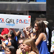 Fan cheer for the The US Women's Soccer Team as they Parades Down NYC's 'Canyon of Heroes', Manhattan New York, during their ticker tape parade after winning the FIFA World Championship. A ceremony at City Hall Plaza followed the parade hosted by Mayor Bill de Blasio. Manhattan, New York, USA 10th July 2015. Photo Tim Clayton