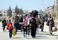 DAMASCUS, Sept. 2, 2016 (Xinhua) -- Syrian civilians carry their belongings to evacuate from the rebel-held town of Muadamiyeh, in rural Damascus, capital of Syria, on Sept. 2, 2016. Nearly 300 civilians, who were originally from the town of Daraya for refuge, were evacuated from Muadamiyeh to government-controlled shelters in southern Damascus. (Xinhua/Ammar (Credit Image: © Ammar/Xinhua via ZUMA Wire)
