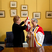 26.04.2017.          <br /> The University of Limerick today conferred Honorary Doctorates on two exceptional individuals from the worlds of business and education, Sr. Angela Bugler and Vincent Roche.&nbsp; <br /> Sr Angela Bugler, former President of Mary Immaculate College Limerick who was conferred with the honorary degree of Doctor of Letters is helped with er robes by Rose Ryan, Phelan Conan Robe Company. Picture: Alan Place.