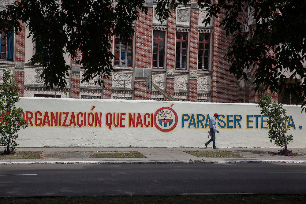 'An organization born to be eternal'. Propaganda messages painted on a wall at Paseo street in Havana, Cuba.