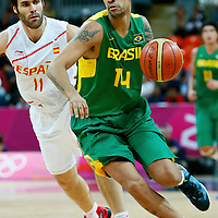 06 August 2012: Brazil Marquinhos Vieira Sousa drives past Spain Fernando San Emeterio as he brings the ball upcourt during 88-82 Team Brazil victory over Team Spain, during the men's basketball preliminary, at the Basketball Arena, in London, Great Britain.