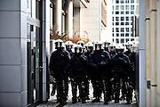 Frankfurt am Main | 18 Mar 2015<br /> <br /> Blockupy-Proteste in Frankfurt am 18.03.2015, hier: W&auml;hrend der Blockupy-Abschlussdemo halten sich zwischen Geb&auml;uden Polizisten bereit.<br /> <br /> photo &copy; peter-juelich.com