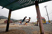 Children play on an ad hoc playground built in the center of the Okirai district of Sanriku Town, Ofunato City, Iwate Prefecture, Japan on  12 June 2011.  The playground was built by recycling debris from the March 11 tsunami with participation by the local children..Photographer: Robert Gilhooly