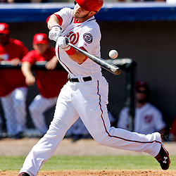 Mar 8, 2013; Melbourne, FL, USA; Washington Nationals center fielder Bryce Harper (34) strikes out swinging against the St. Louis Cardinals during the bottom of the first inning of a spring training game at Space Coast Stadium. Mandatory Credit: Derick E. Hingle-USA TODAY Sports