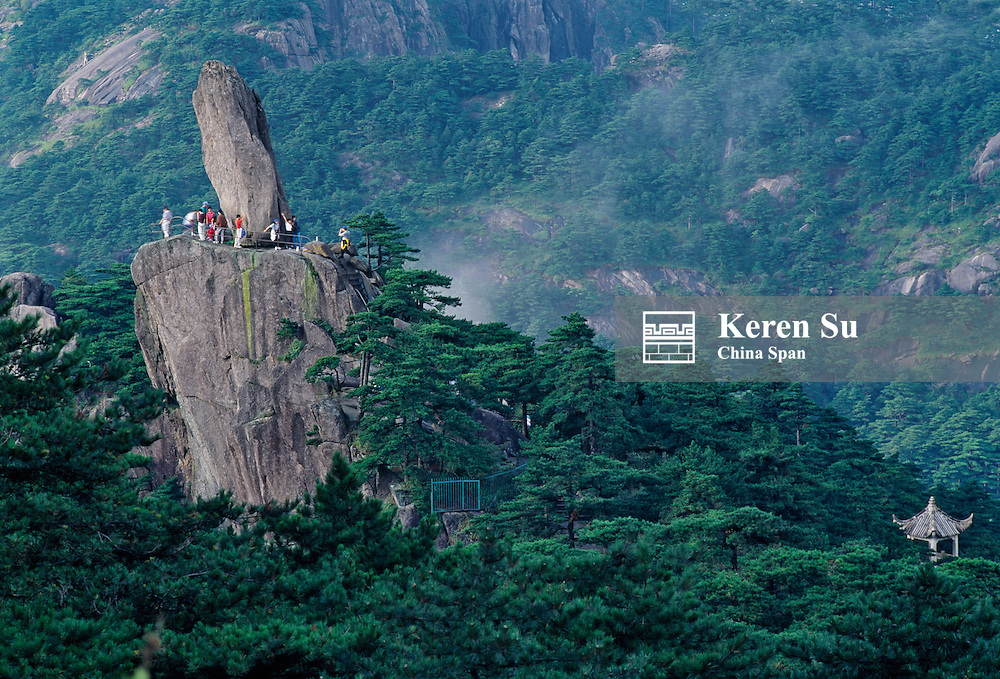 China, Anhui Province, Mount Huangshan, tourists with Flying Stone