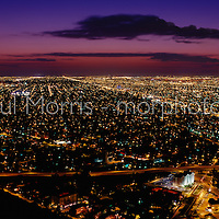 Aerial of Miami at Twilight looking west from Brickell Avenue showing the city lights of Miami's suburbs. This version is watermarked, contact us for a  license and clean version.