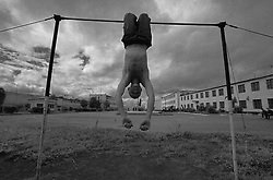 Russian young prisoner hangs on the horizontal bar at the colony for prisoner's children in Siberian town Leninsk-Kuznetsky, Russia, 04 July 2001.