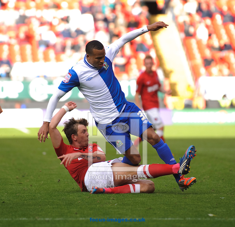 Picture by Gerald O'Rourke/Focus Images Ltd +44 7500 165179.29/09/2012.Dale Stephens of Charlton Athletic and Bruno Ribeiro of Blackburn Rovers during the npower Championship match at The Valley, London.