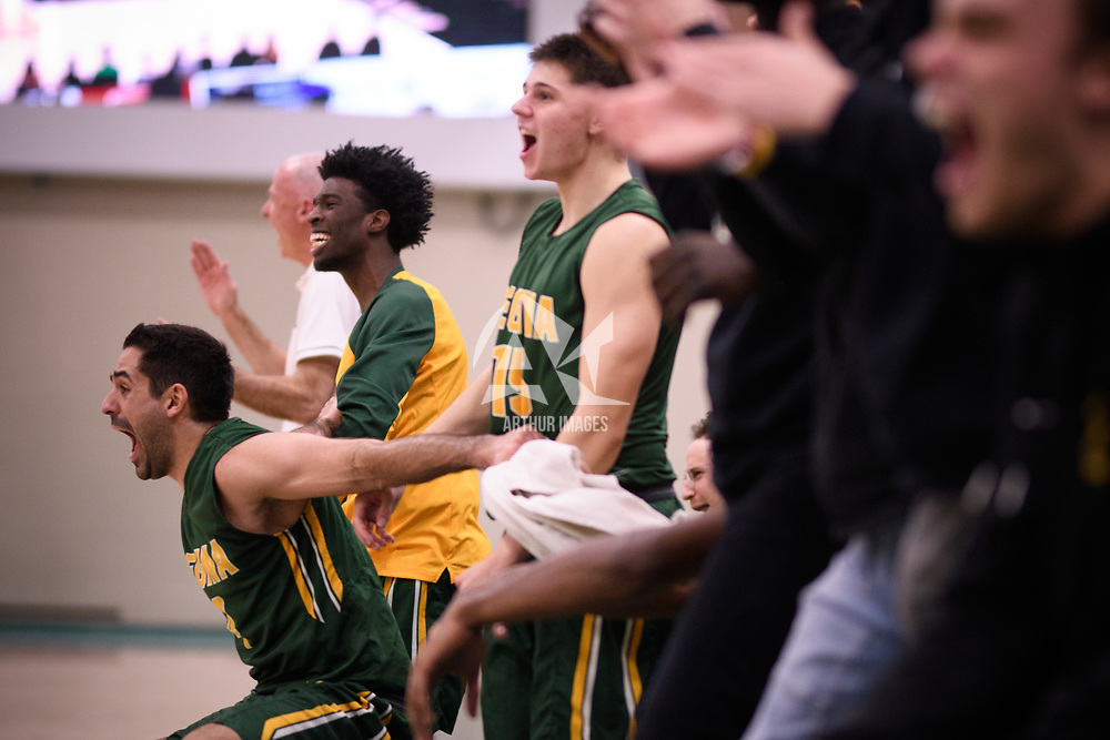 The bench explodes in celebration during the Men's Basketball home game on November 11 at Centre for Kinesiology, Health and Sport. Credit: Arthur Ward/Arthur Images