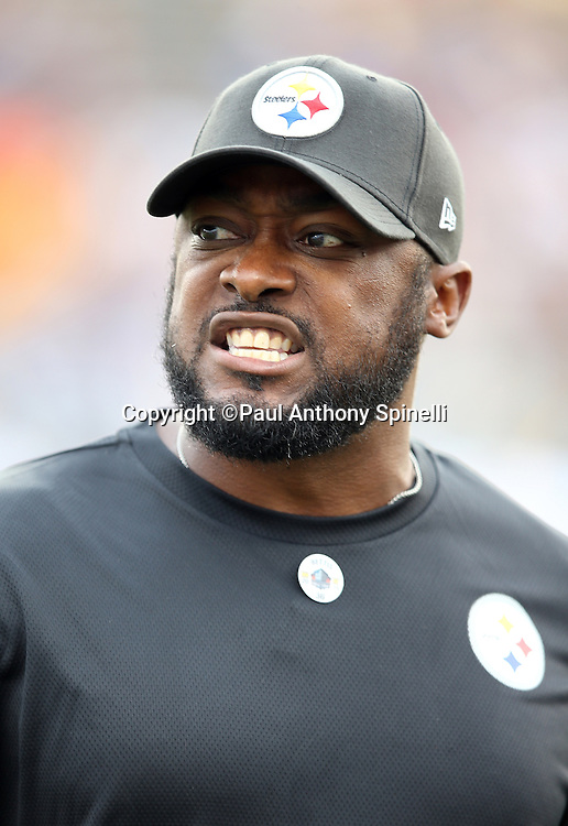Pittsburgh Steelers head coach Mike Tomlin grits his teeth on the sideline during the 2015 NFL Pro Football Hall of Fame preseason football game against the Minnesota Vikings on Sunday, Aug. 9, 2015 in Canton, Ohio. The Vikings won the game 14-3. (©Paul Anthony Spinelli)