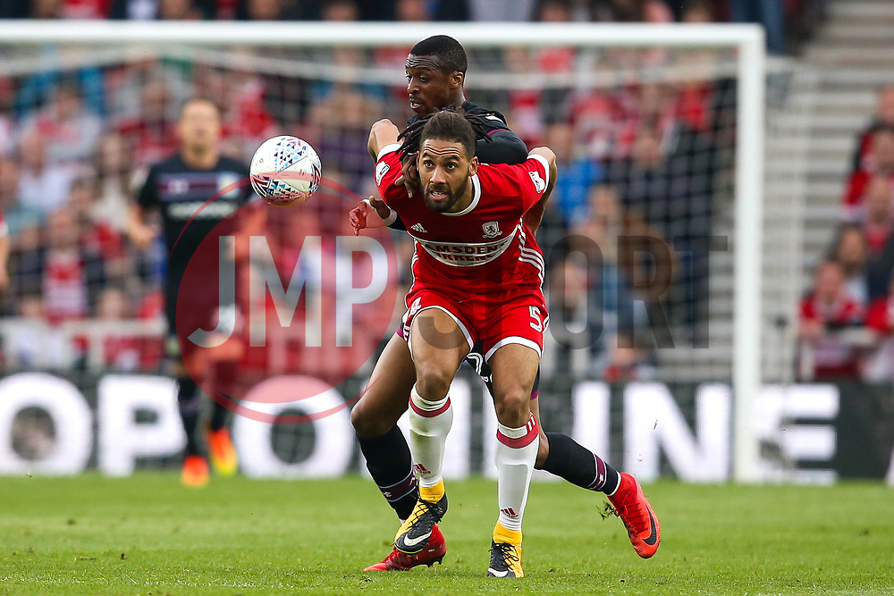 Jonathan Kodjia of Aston Villa challenges Ryan Shotton of Middlesbrough - Mandatory by-line: Robbie Stephenson/JMP - 12/05/2018 - FOOTBALL - Riverside Stadium - Middlesbrough, England - Middlesbrough v Aston Villa - Sky Bet Championship