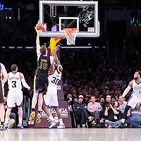 28 February 2014: Los Angeles Lakers center Pau Gasol (16) goes for the skyhook over Sacramento Kings power forward Reggie Evans (30) during the Los Angeles Lakers 126-122 victory over the Sacramento Kings at the Staples Center, Los Angeles, California, USA.