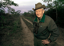 December 1999. Royal Chitwan National Park, Nepal.<br /> World renowned tiger ecologist, conservationist, researcher and writer Chuck McDougal stands on a track in the jungle as he and his team prepare to track the elusive jungle cats. <br /> Charles McDougal died on 11 May in Kathmandu surrounded by his family.<br /> Photo&copy; Charlie Varley/varleypix.com