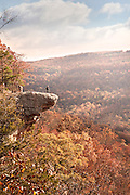 A man enjoys the autumn sunrise view on top of the Hawksbill Crag along the Whitaker's Point Trail in Northern Arkansas.