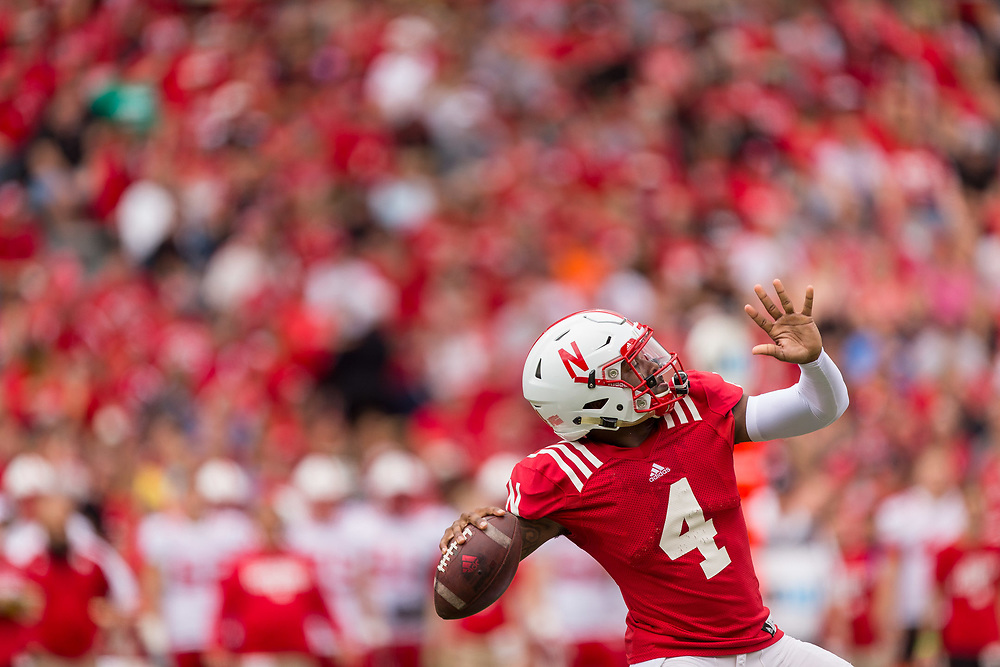 Tommy Armstrong Jr. #4 throws a deep pass on the opening play of the annual Red White Spring Game at Memorial Stadium on April 16, 2016. Photo by Aaron Babcock, Hail Varsity
