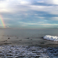 The surfers pot of gold seems to be at Steamer Lane in Santa Cruz, California as a rainbow colors the sky during a large winter swell on December 9.