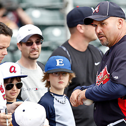 March 5, 2011; Lake Buena Vista, FL, USA; Atlanta Braves manager Fredi Gonzalez (33) signs autographs before a spring training exhibition game against the New York Mets at Disney Wide World of Sports complex.  Mandatory Credit: Derick E. Hingle