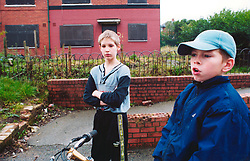 Two young boys on run down council estate; Leeds