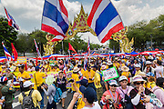 "09 MAY 2014 - BANGKOK, THAILAND: Anti-government protestors jam Ratchadamnoen Ave on the west side of Government House in Bangkok. Thousands of Thai anti-government protestors took to the streets of Bangkok Friday to start their ""final push"" to bring the popularly elected of government of Yingluck Shinawatra. Yingluck has already been forced out by a recent court ruling that forced her to resign and she is facing indictment by the National Anti Corruption Commission of Thailand for alleged improprieties related to a government rice price support scheme. The protestors Friday were marching to demand that she not be allowed to return to politics. The courts have not banned her party, Pheu Thai, which has formed an interim caretaker government to govern until elections expected in July, 2014. Suthep Thaugsuban, secretary-general of the People's Democratic Reform Committee (PDRC),  said the president of the Supreme Court and the new senate speaker, who would be selected Friday, should set up an ""interim people's government and legislative assembly."" He went onto say that if they didn't, he would.     PHOTO BY JACK KURTZ"